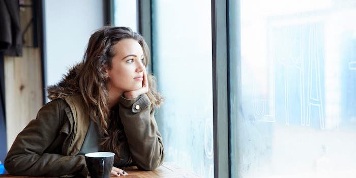 Late teens girl looking out of window